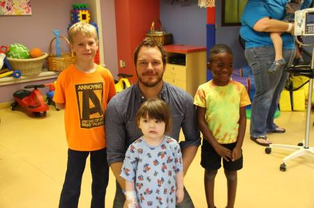 Chris poses with the kids.
