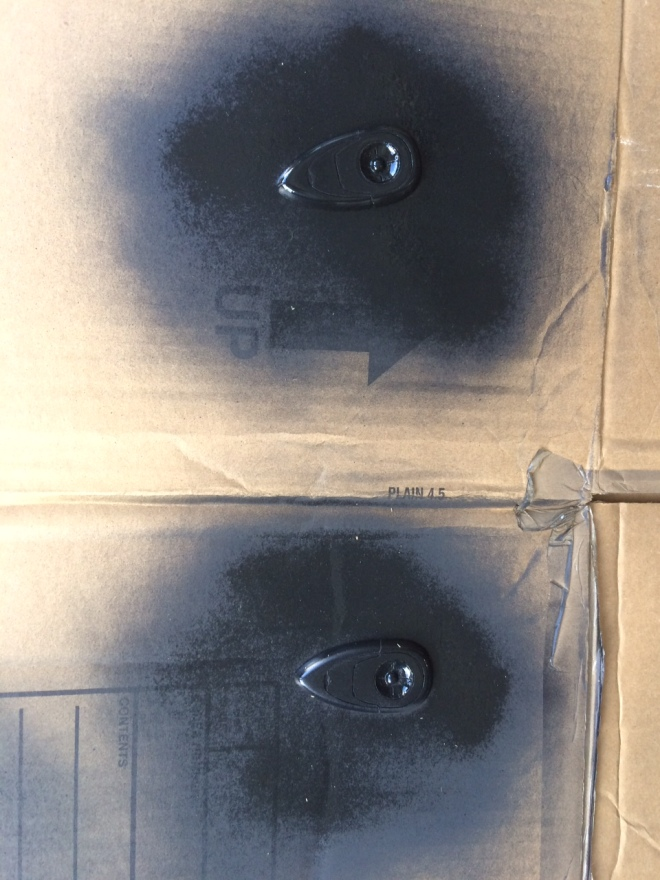 Spray painting the booster controls. I made sure not to fill the grooves with paint by overdoing it with the paint.